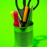 cup with pens highlighters scissors Image